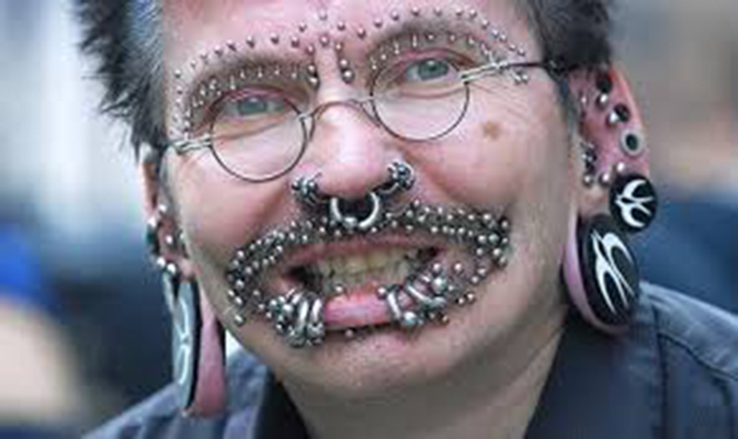 Face full of piercings